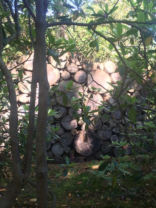 log wall at Sakonnet Garden