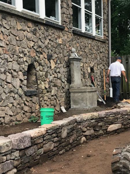 Backyard Stone Wall Before